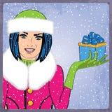 典雅的年轻和愉快的妇女在冬天,减速火箭的圣诞卡 免版税库存图片