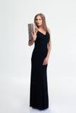 典雅的黑礼服的美丽的妇女 库存图片