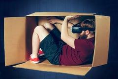 内向概念 坐在有虚拟现实玻璃的箱子里面的人  未来技术概念 图库摄影