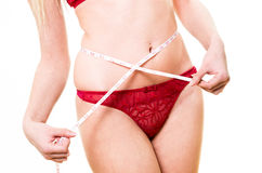 内裤的妇女有白色措施磁带的 图库摄影