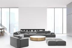 内部白色的客厅,灰色沙发 库存例证