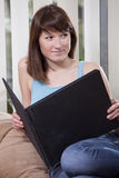 册页照片沙发妇女 图库摄影