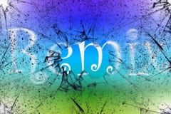 再混合概念与再混合在残破的玻璃后被写的词有五颜六色的背景 图库摄影