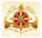 冒险指南针象征金黄玫瑰色葡萄酒 免版税库存照片