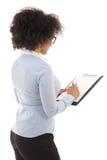 写一些的后面观点的年轻美丽的非裔美国人的妇女 免版税库存照片
