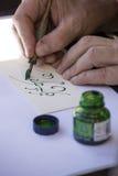 写与绿色笔的街道画家凯尔特名字 免版税图库摄影