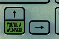 写您关于的手写文本是优胜者 赢取作为第1个地方或冠军的概念意思在竞争中 免版税库存图片