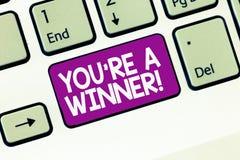 写您关于的手写文本是优胜者 赢取作为第1个地方或冠军的概念意思在竞争中 免版税库存照片