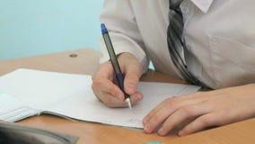 写文本的男小学生在习字簿 股票视频