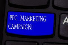 写概念性的手显示Ppc市场活动 企业照片文本付费,每次他们的一个广告是 免版税库存图片