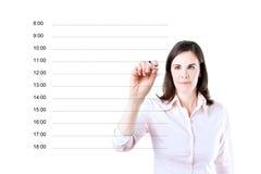 写空白的任命日程表的女商人 免版税库存照片