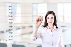 写空白的任命日程表的女商人 库存照片