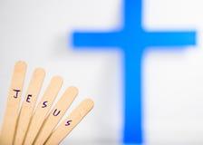 写耶稣文本在木头 免版税图库摄影