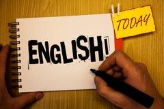 写英国诱导电话的手写文本 与英国相关的概念意思它的人民或他们的语言人举行举行 免版税图库摄影