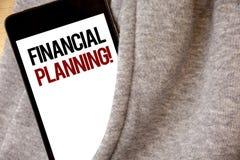 写财政规划诱导电话的手写文本 概念意思会计计划战略分析树冰col 免版税库存图片