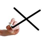 写黑十字架的手在透明whiteboard 库存图片