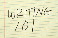 写101在一本黄色便笺簿 免版税库存图片