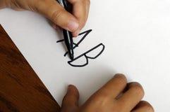 写AB的手孩子 免版税库存图片