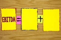 写Ebitda的手写文本 概念意思收入,在税被测量评估在稠粘前写的公司表现 库存照片