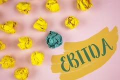 写Ebitda的手写文本 概念意思收入,在税被测量评估在Painte前写的公司表现 图库摄影