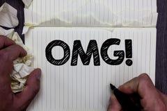 写Omg诱导电话的手写文本 概念意思哦我的好简称现代惊讶表示笔记本关于 免版税库存图片
