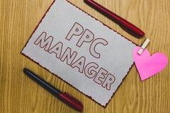 写Ppc经理的手写文本 登广告者每次支付费他们的广告一的概念意思是点击的片断纸 库存图片