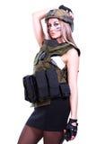 军事伪装的妇女与携带无线电话 免版税库存图片