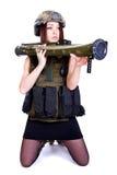 军事伪装的妇女与枪榴弹发射器 免版税库存照片