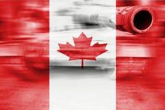 军事力量题材,与加拿大旗子的行动迷离坦克 库存照片