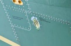 军事直升机伪装 军用飞机细节伪装 关于机体的看法与盘区线和梯度颜色 库存照片