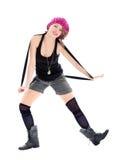军事靴子和桃红色帽子的滑稽的少妇 免版税图库摄影