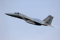 军事F15喷气式歼击机飞机飞行 免版税库存图片