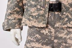 军用伪装衣裳和传送带在时装模特 库存照片