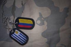 军队空白、卡箍标记与哥伦比亚的旗子和乌拉圭卡其色的纹理背景的 图库摄影