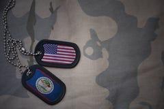 军队空白、卡箍标记与美国的旗子和伯利兹卡其色的纹理背景的 图库摄影