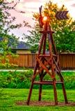 农厂风车在黎明 库存图片