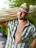 农夫在工作自温室 免版税图库摄影