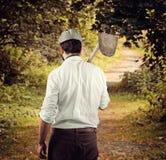 农夫从后面在国家边 免版税库存图片