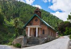 农村天主教会由砖做了红色 免版税图库摄影