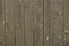 农村篱芭的老木板灰色棕色背景  免版税图库摄影