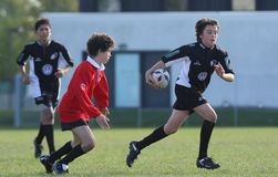 冠军橄榄球青年时期 库存照片