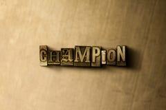 冠军-脏的葡萄酒在金属背景的被排版的词特写镜头  库存照片