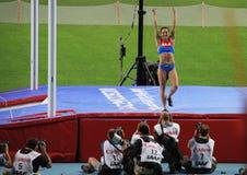 冠军E 在撑竿跳高以后的伊辛巴耶娃 免版税库存图片