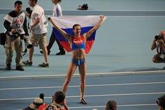 冠军E 有俄国旗子的伊辛巴耶娃 库存图片