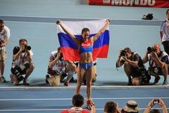冠军E 有俄国旗子的伊辛巴耶娃 免版税图库摄影