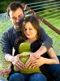 冥想夫妇即将发布的年轻人的婴孩诞&# 免版税图库摄影