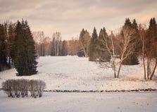 冬天与河的日落风景 免版税图库摄影