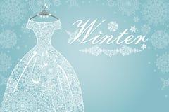 冬天卡片 有雪花鞋带的新娘礼服 免版税图库摄影