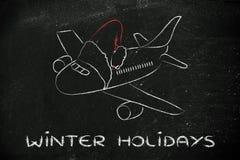 冬天和圣诞节假日:有圣诞老人帽子的飞机 免版税图库摄影