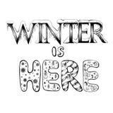 冬天在这里,传染媒介字法 免版税库存照片